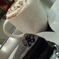 Photo taken at Starbucks by nat n. on 12/21/2012