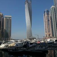 Photo taken at Dubai Marina Walk by Halil D. on 10/25/2012