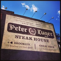 Photo taken at Peter Luger Steak House by Miguel C. on 5/26/2013