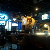 Photo taken at Puck Restaurant & Sports Bar by Judy W. on 12/4/2012