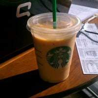 Photo taken at Starbucks by Robynne M. on 7/16/2012