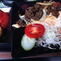 Photo taken at Hoka Hoka Bento by peny b. on 10/11/2012