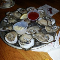 Photo taken at Floyd's Cajun Seafood - Webster by Ryan M. on 12/22/2012