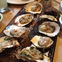Photo taken at La Docena Oyster Bar & Grill by César T. on 6/21/2013