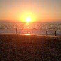 Photo taken at Playa de los Muertos by Bessie on 2/17/2013
