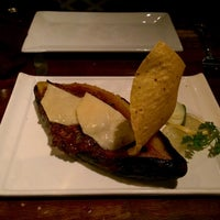 Photo taken at Cava Wine Bar by Vanessa S. on 11/19/2014