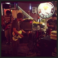 Photo taken at Woodstock Bar & Grill by Poyee C. on 1/19/2013