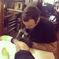 Photo taken at Three Kings Tattoo Parlor by Andy S. on 3/7/2013