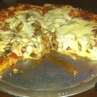 Photo taken at Filippi's Pizza Grotto by Derek H. on 7/28/2012