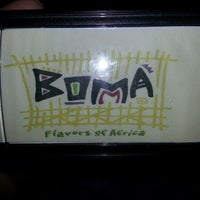 Photo taken at Boma Flavors of Africa by Milly A. on 10/1/2012
