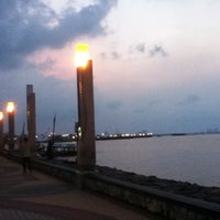 Photo taken at Ancol Beach by Thierza M. on 4/27/2013