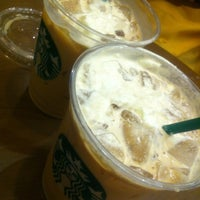 Photo taken at Starbucks by Natsumi A. on 7/6/2013