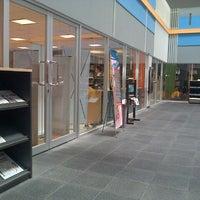 Photo taken at Library BINUS University by Carissa G. on 10/3/2012
