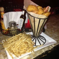 Photo taken at Rebel Bar & Grill by Deedee A. on 1/20/2013