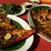 Photo taken at Kampung seafood Jimbaran by sarah r. on 12/9/2014