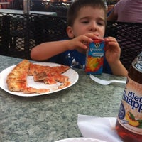 Photo taken at Knapp St Pizza by Vanessa P. on 8/6/2013