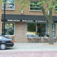 Photo taken at Brick Road Pizza Co. by Sarah P. on 12/27/2012