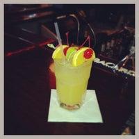 Photo taken at Iris Lounge by Christy J. on 9/20/2013