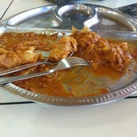 Photo taken at Mano Mega Curry House by Garnette A. on 6/11/2013