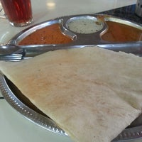 Photo taken at Mano Mega Curry House by Garnette A. on 7/12/2013