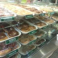 Photo taken at Krispy Kreme Doughnuts by Rainbow E. on 5/24/2013