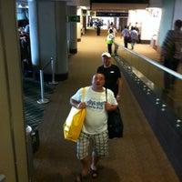Photo taken at Gate 5 Aeropuerto Internacional Juan Santamaria by Superlass on 11/19/2012