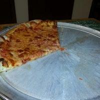 Photo taken at Domenick & Pia Downtown Pizzeria by Ruben T. on 1/12/2013