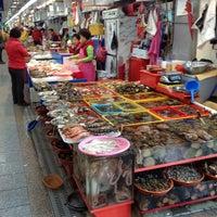 Photo taken at Jagalchi Fish Market by Aakom on 3/30/2013