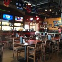 Photo taken at Boston Pizza by Shluba K. on 3/20/2013