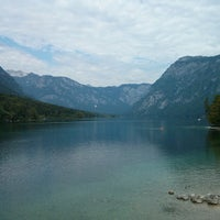 Photo taken at Bohinjsko jezero (Bohinj Lake) by Nacho L. on 7/23/2013