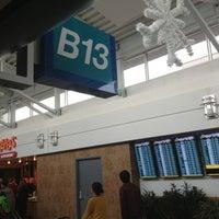 Photo taken at Gate B13 by Jason N. on 12/22/2012