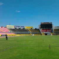 Photo taken at Estadio Olimpico Atahualpa by Camila W. on 9/28/2012