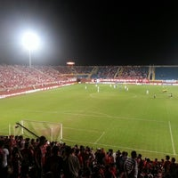 Photo taken at Estádio Arena Joinville by Fabiano L. on 10/9/2012