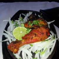 Photo taken at Cuisine of India by Himangshu S. on 9/30/2012
