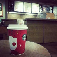 Photo taken at Starbucks by mini~hotty on 11/29/2012