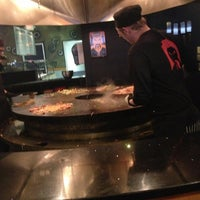 Photo taken at HuHot Mongolian Grill by Adrian B. on 6/29/2013