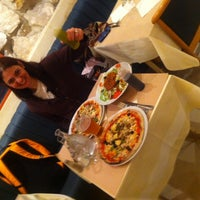 Photo taken at Pizza Momo by Chris M. on 4/27/2014