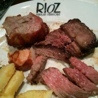 Photo taken at Rioz Brazilian Steakhouse by Colleen R. on 2/24/2013