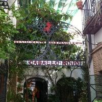 Photo taken at Restaurante El Caballo Rojo by Javier C. on 10/13/2012