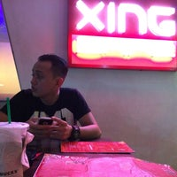 Photo taken at Xing Cafe & KTV Restobar by chacha e. on 6/28/2014