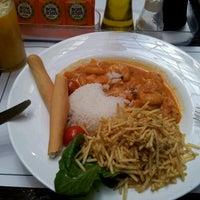 Photo taken at Café Caliente by Fabio X. on 11/15/2012