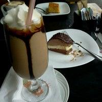 Photo taken at Terzetto Café by Allysson M. on 11/12/2011
