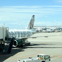 Photo taken at Frontier Airlines (Gates 24 - 32) by Dannon R. on 4/13/2012