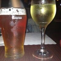 Photo taken at Mulligan's Pub by Sara B. on 8/15/2012