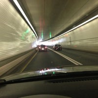 Photo taken at Fort McHenry Tunnel Toll Plaza by JB J. on 4/15/2013