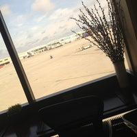 Photo taken at Delta Sky Club by Sara S. on 5/21/2013