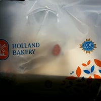 Photo taken at Holland Bakery by Ramadhani T. on 4/10/2014