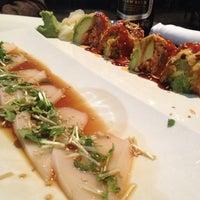 Photo taken at Sweet Ginger Asian Bistro & Sushi by Ryan on 2/23/2013