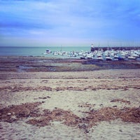 Photo taken at Plage de Saint-Jacques by Alice B. on 8/11/2015