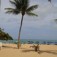 Photo taken at Praia de Tambaú by Henrique S. on 1/20/2013